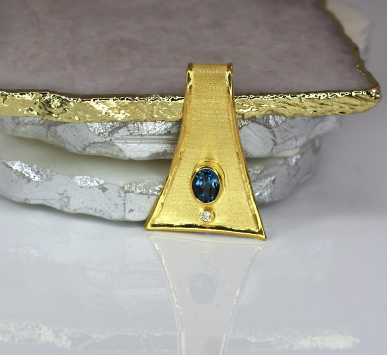 This is triangular shape Yianni Creations pendant crafted all by hand in Greece from 18 Karat gold using special ancient techniques of craftsmanship -  velvet byzantine brush on the background in combination with liquid edges. The pendant is