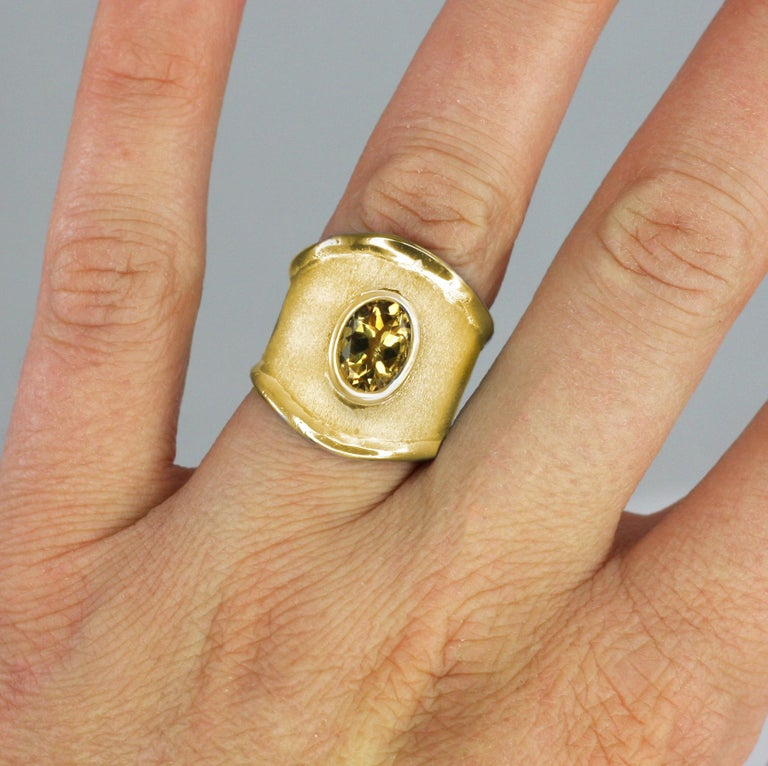 Contemporary Yianni Creations 18 Karat Yellow Gold Wide Band Ring with a Oval Citrine For Sale