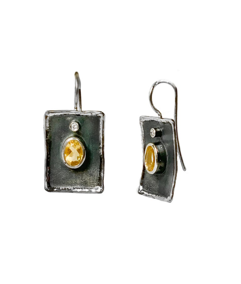 Create a dramatic look with Yianni Creations Hephestos Collection handmade artisan earrings from fine silver 950 purity plated with palladium to protect the jewel from the elements. Each earring features 1.25 Carat Citrine accompanied by a 0.03