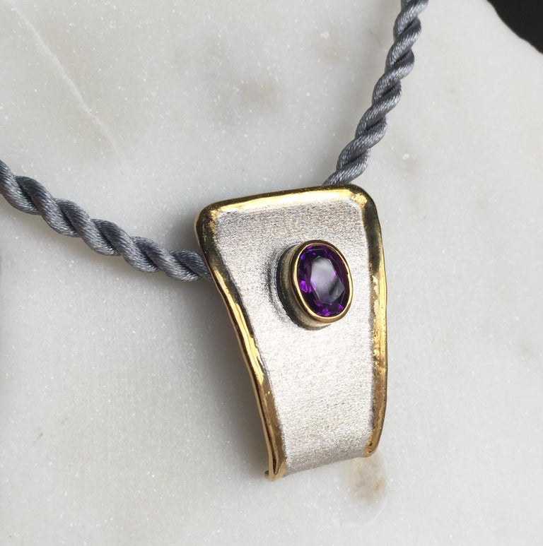 Yianni Creations pendant enhancer from Midas Collection is all handcrafted from fine silver 950 purity and plated with palladium to resist the elements. This stunning artisan pendant attracts by brushed texture and nature-inspired liquid edges in