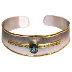 Yianni Creations Blue Topaz Diamonds Silver and Gold Two-Tone Bangle Bracelet