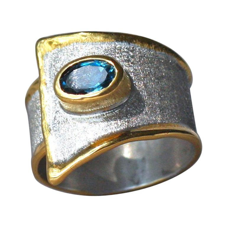 Yianni Creations Blue Topaz Fine Silver 24 Karat Gold Two-Tone Wide Band Ring