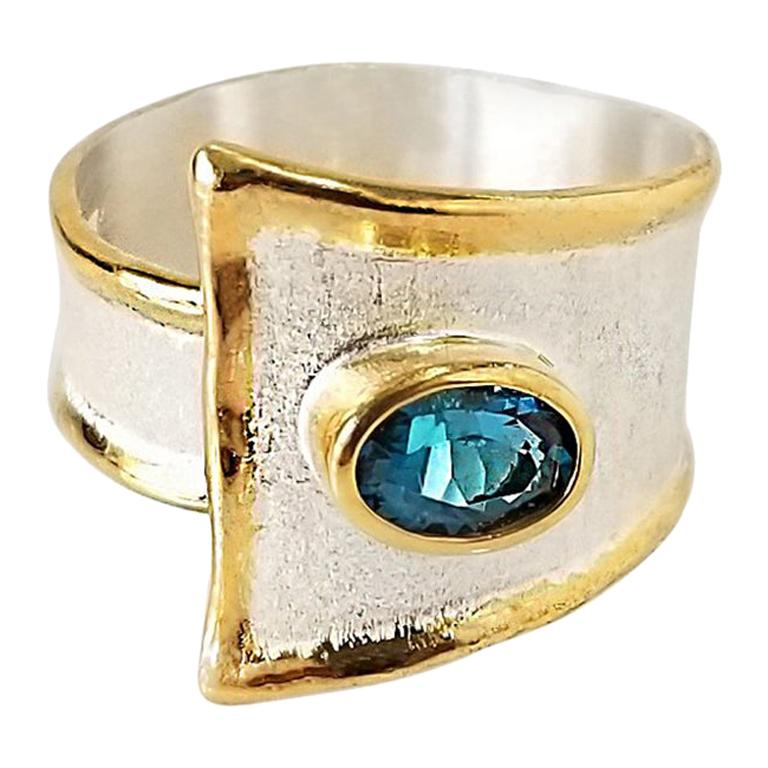 Yianni Creations Blue Topaz Fine Silver and 24 Karat Gold Two-Tone Band Ring
