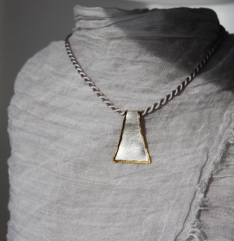 This is triangular shape Yianni Creations pendant from Midas Collection all handmade in Greece from fine silver 950 purity and plated with palladium to resist tarnish. This artisan pendant enhancer in its purity shines due to its texture. The velvet