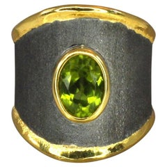 Yianni Creations Fine Silver and Gold Two-Tone Peridot Thick Band Rhodium Ring