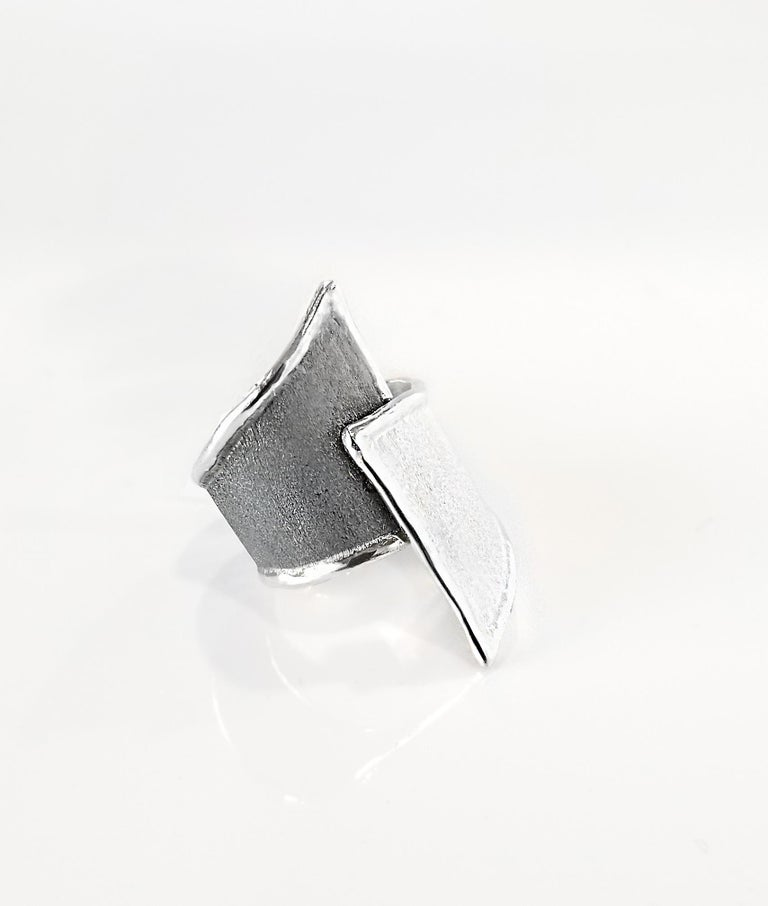 Yianni Creations Hephestos Collection 100% Handmade Artisan Ring from Fine Silver. Ring features unique oxidized Rhodium background in contrast with the white opposite. Ring presents unique techniques of craftsmanship - brushed texture and