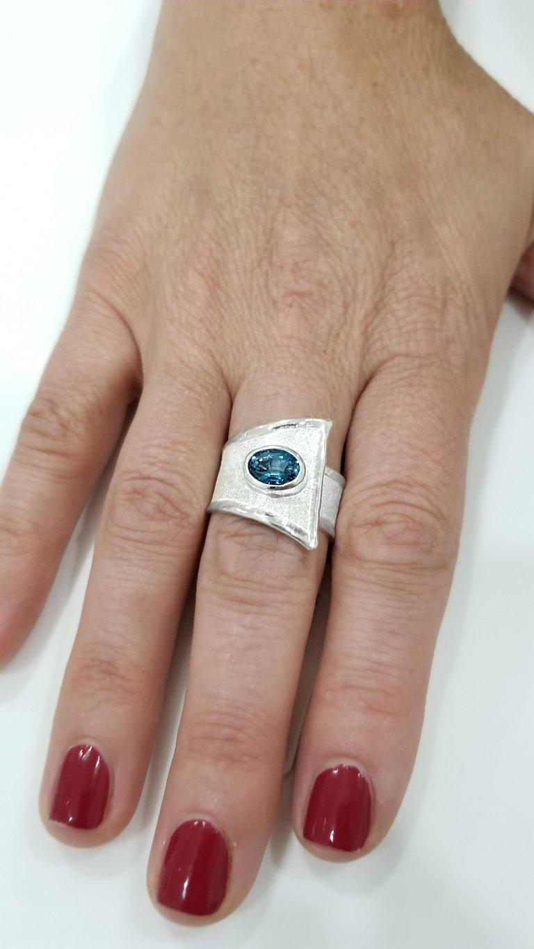 Contemporary Yianni Creations Blue Topaz Fine Silver Solitaire Adjustable Wide Band Ring For Sale