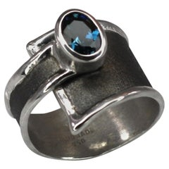Yianni Creations London Blue Topaz Ring in Fine Silver and Black Rhodium