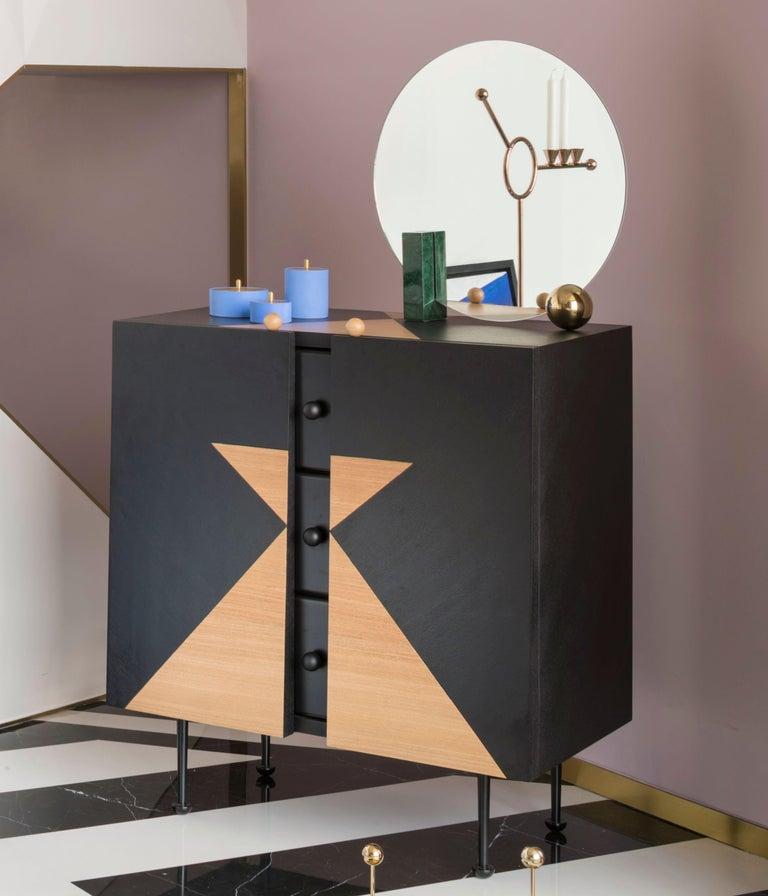 Yin-Yang chest drawers designed by Thomas Dariel, Maison Dada Measures: W 80 x D47 x H93 cm Body in painted and natural ash veneer • front in matte paint ?nish Structure in MDF • Inside drawers painted in black matte ?nish Metal legs with black