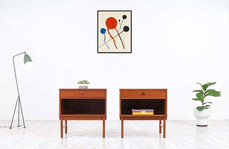 Scandinavian Modern nightstands designed by Swedish architect Yngve Ekström in collaboration with DUX of Sweden in 1960s. These alluring Model 518 nightstands are crafted in warm teak wood that feature a single dovetailed drawer and a lower open