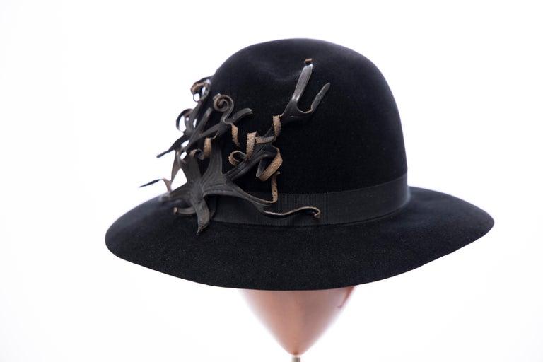 Yohji Yamamoto Pour Homme, ca. 1990's black wool felt fedora hat with black grosgrain ribbon and appliquéd black leather detail.  Circumference: 24.25