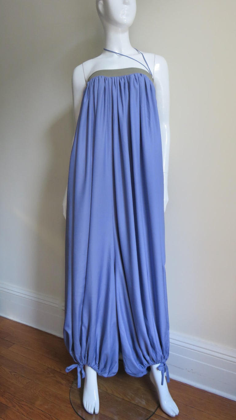 An incredible strapless lavender blue fine knit jumpsuit from Yohji Yamamoto's 2002 collection.  It is strapless with a grey band and a matching adjustable drawstring at the top (worn tied around the neck on the runway). It is fully gathered from