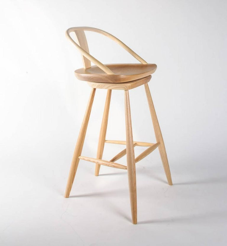 Solid ash barstool in natural finish is bench made in Great Britain.
