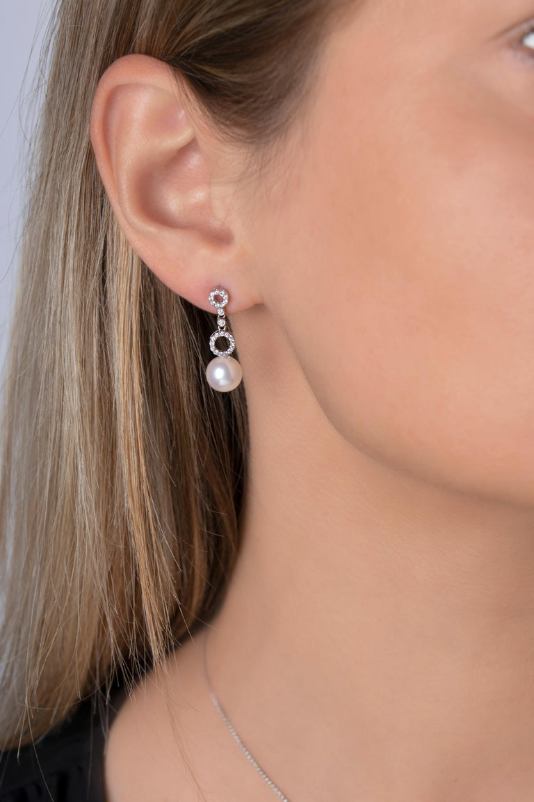 These elegant earrings by Yoko London feature pretty diamond-set open circles which cascade vertically towards a lustrous Cultured Japanese Akoya Pearl. Forever elegant and sophisticated, these earrings can easily be styled with both casual and more