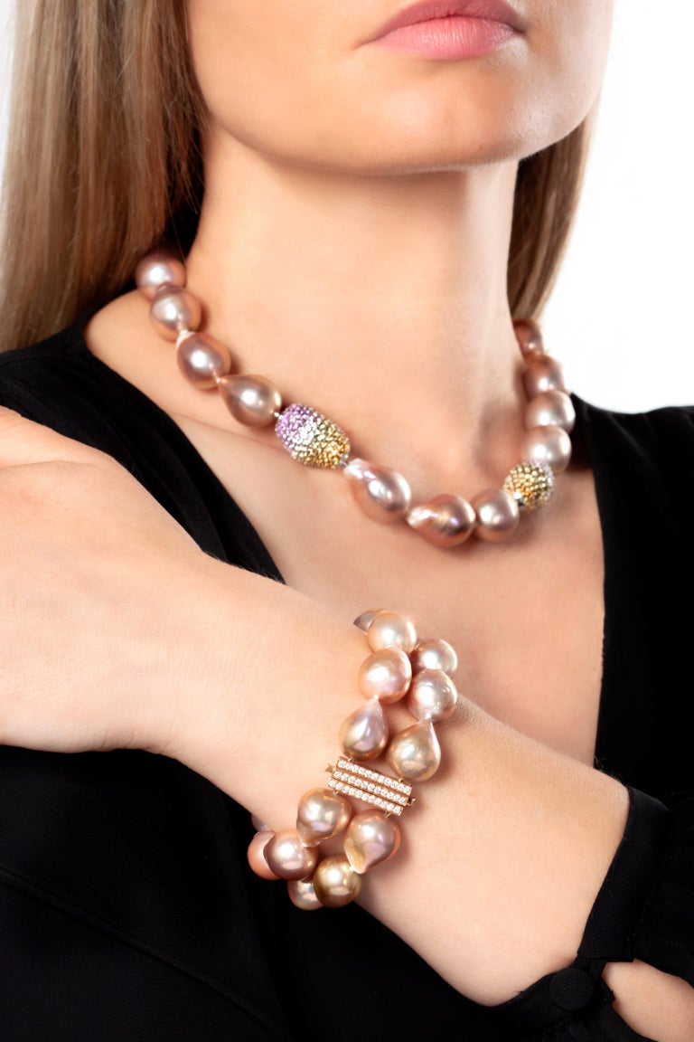 This hypnotic bracelet by Yoko London features two rows of unique, pink baroque pearls. Each baroque pearl is completely unique and this design perfectly highlights their allure and mystique. The rich, pink hues of the pearls are perfectly offset by