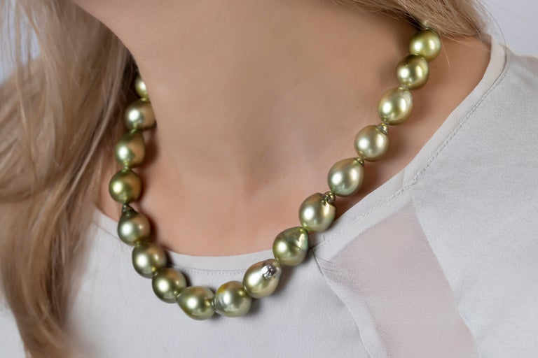 This unique necklace by Yoko London featured baroque shaped pistachio-coloured Tahitian pearls, completed with a simple white gold strand. Each baroque pearl is completely unique and this design perfectly highlights their individual allure and
