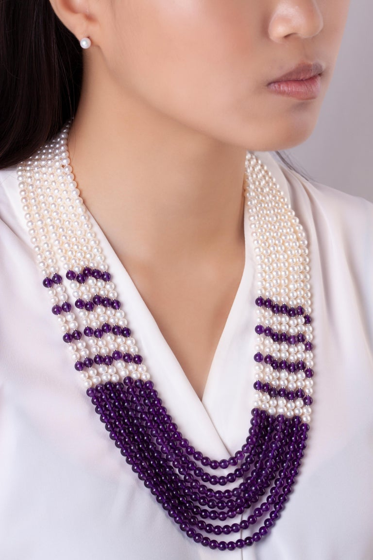 This unique seven row Freshwater pearl and amethyst necklace by Yoko London is simultaneously striking and elegant. Expertly hand crafted in our London atelier, this spectacular necklace will add a sumptuous pop of colour to any outfit.  -5-5.5mm