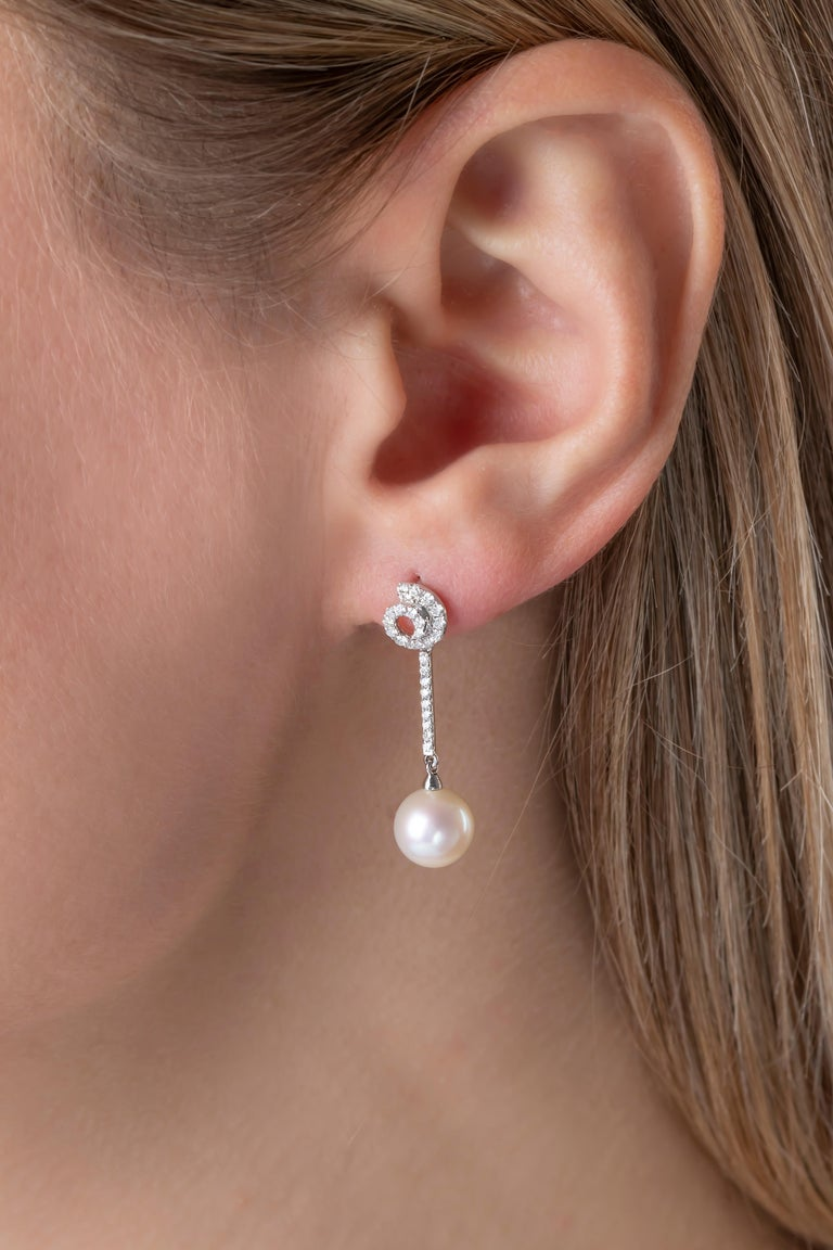 These intricate earrings by Yoko London feature lustrous Freshwater pearls beneath a contemporary arrangement of diamonds. These earrings are the perfect accessory for any special occasion, adding an unparalleled touch of elegance to any outfit.