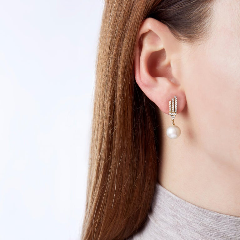 These elegant earrings by Yoko London feature lustrous 9-9.5mm Freshwater pearls beneath a striking arrangement of diamonds. Pair these intricate earrings with any evening look to add a touch of unparalleled elegance.   -9-9.5mm Freshwater Pearls