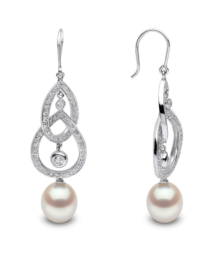 Featuring a stunning array of diamond swirls, atop a 9.5mm drop-shaped cultured freshwater pearl, these earrings are a delicate delight sure to add a feeling of glamour to any outfit. Made with a hook earring fitting, these earrings are easy to put