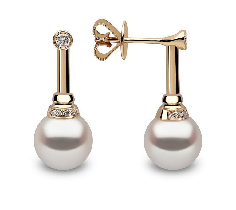 These sleek earrings by Yoko London feature a lustrous Freshwater pearl suspended beneath a single diamond and simple 18 Karat yellow gold setting. Perfect to add an elegant finish to both daytime and evening looks.   - Freshwater Pearls 9.5-10mm -