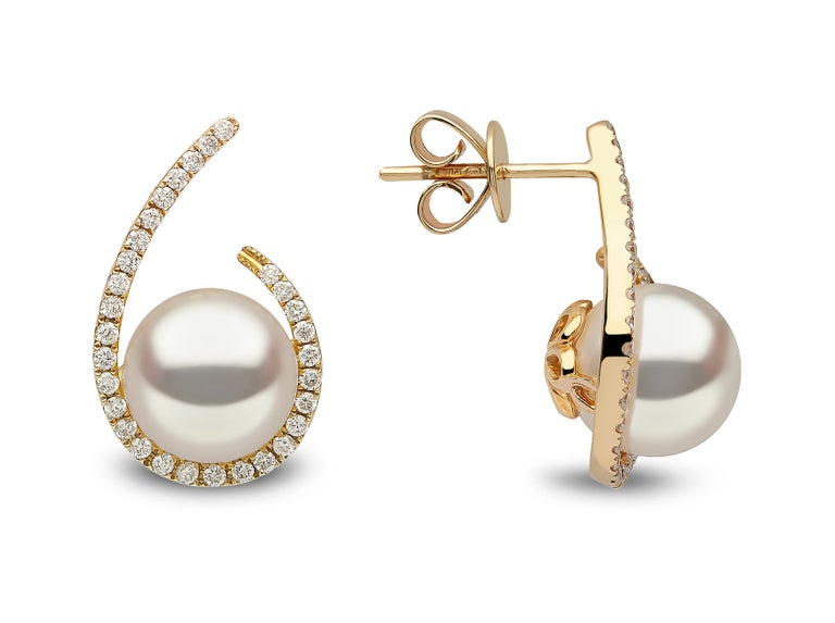 These contemporary earrings by Yoko London feature lustrous Freshwater pearls surrounded by a scintillating swirl of diamonds. Designed and hand finished in our London atelier, the pearls featured in these earrings have been expertly selected