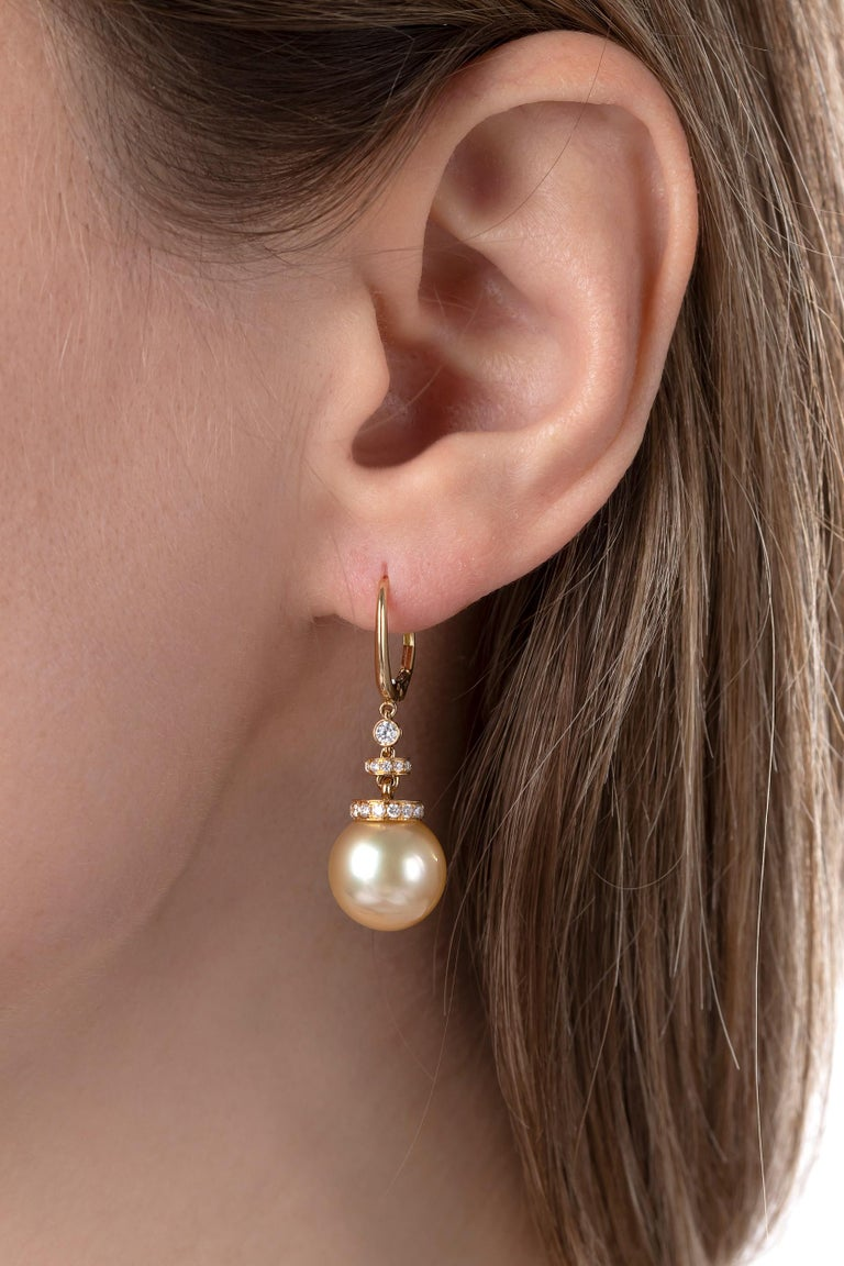 These mesmerising earrings by Yoko London feature rich 12-13mm Golden South Sea pearls beneath clean diamond lines. A contemporary design that has an air of timelessness, these unique earrings have been hand-crafted by experts in our London atelier.