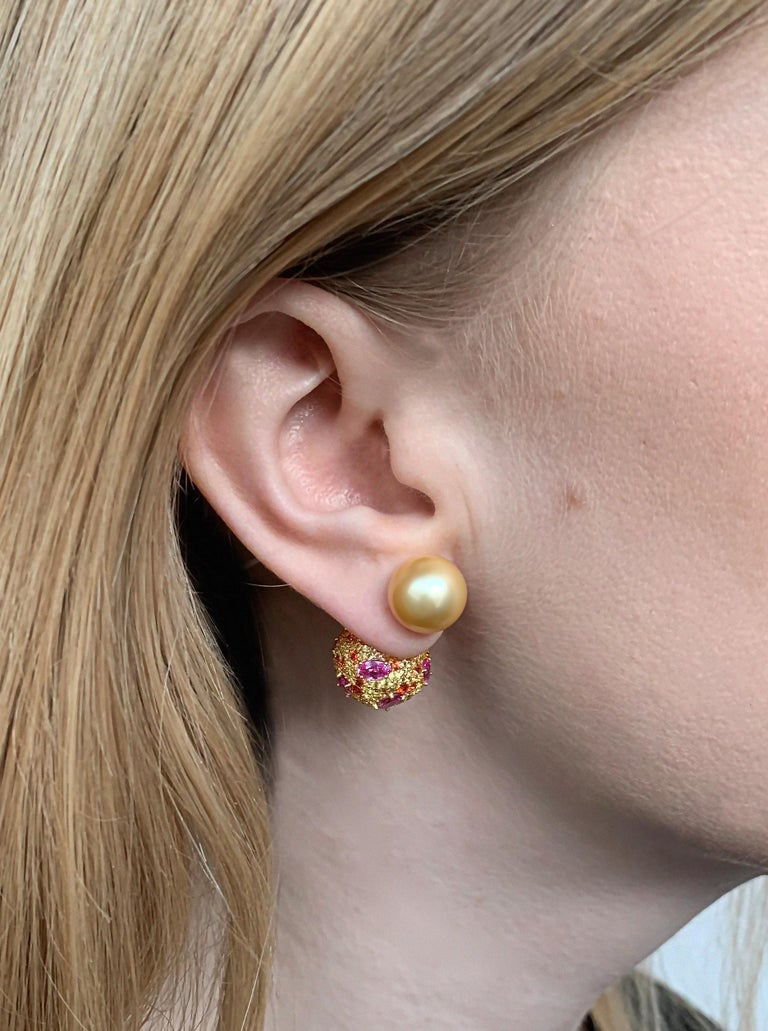These contemporary earrings by Yoko London combine vibrant Golden South Sea pearls with the vivid tones of Pink and Orange Sapphires. Putting style at the forefront of their design, these unique earrings offer a contemporary way to wear pearls –