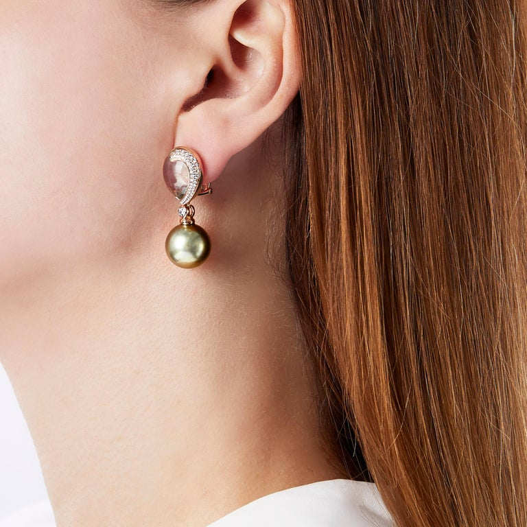 These unique earrings by Yoko London feature a lustrous Pistachio coloured Tahitian pearl beneath a mesmerising Green Amethyst. Set in warm 18 Karat Rose Gold to enrich the hue of gems. These stunning earrings exude a captivating elegance, a perfect
