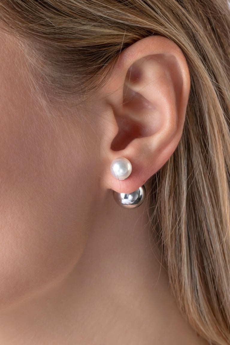 These striking earrings by Yoko London combine lustrous Akoya pearls with a white gold sphere. Putting style at the forefront of their design, these unique earrings offer a contemporary way to wear pearls – perfect for the modern woman. The Akoya