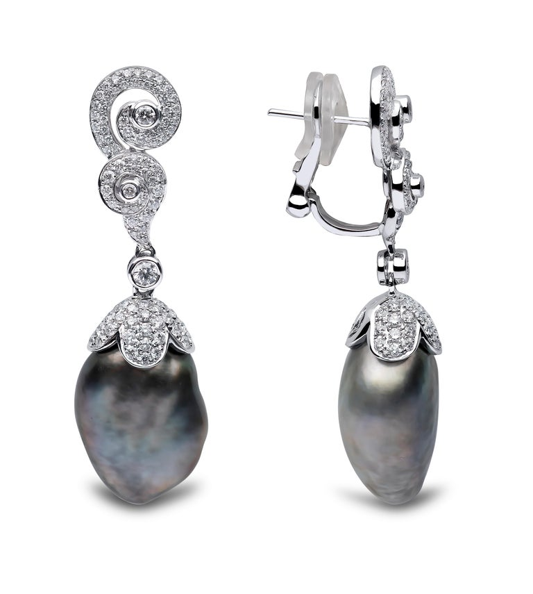 These striking earrings by Yoko London feature one of a kind Keshi Tahitian pearls beneath a scintillating arrangement of diamonds, designed to perfectly enhance the unique features of these spectacular pearls. Pair these spectacular earrings with