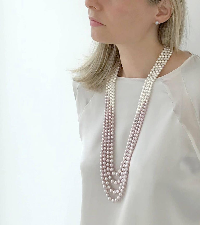 This bold Necklace by Yoko London displays a delicate pattern of Pink Freshwater Pearls at its forefront and rear, with an intersecting section of White Freshwater Pearls.  The Pearls within each row gently graduate in size, and secured to an 18