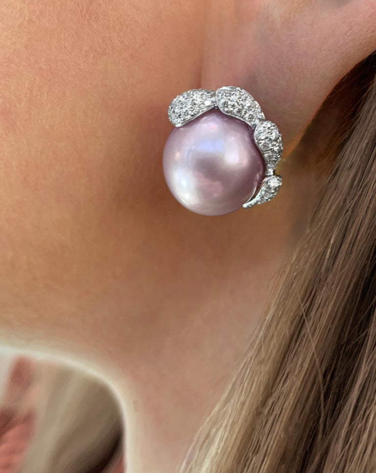These unique earrings by Yoko London feature pink Freshwater pearls at their centre. Designed and hand-finished in our London atelier, these earrings feature scintillating diamond petals which serve to perfectly enrich the striking colour of these