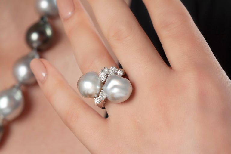 This hypnotic ring by Yoko London features two mesmeric 13-14mm South Sea Keshi pearls, set amongst a delicate scattering of diamonds. Each Keshi pearl is completely unique and this design perfectly highlights the allure and mystique of these