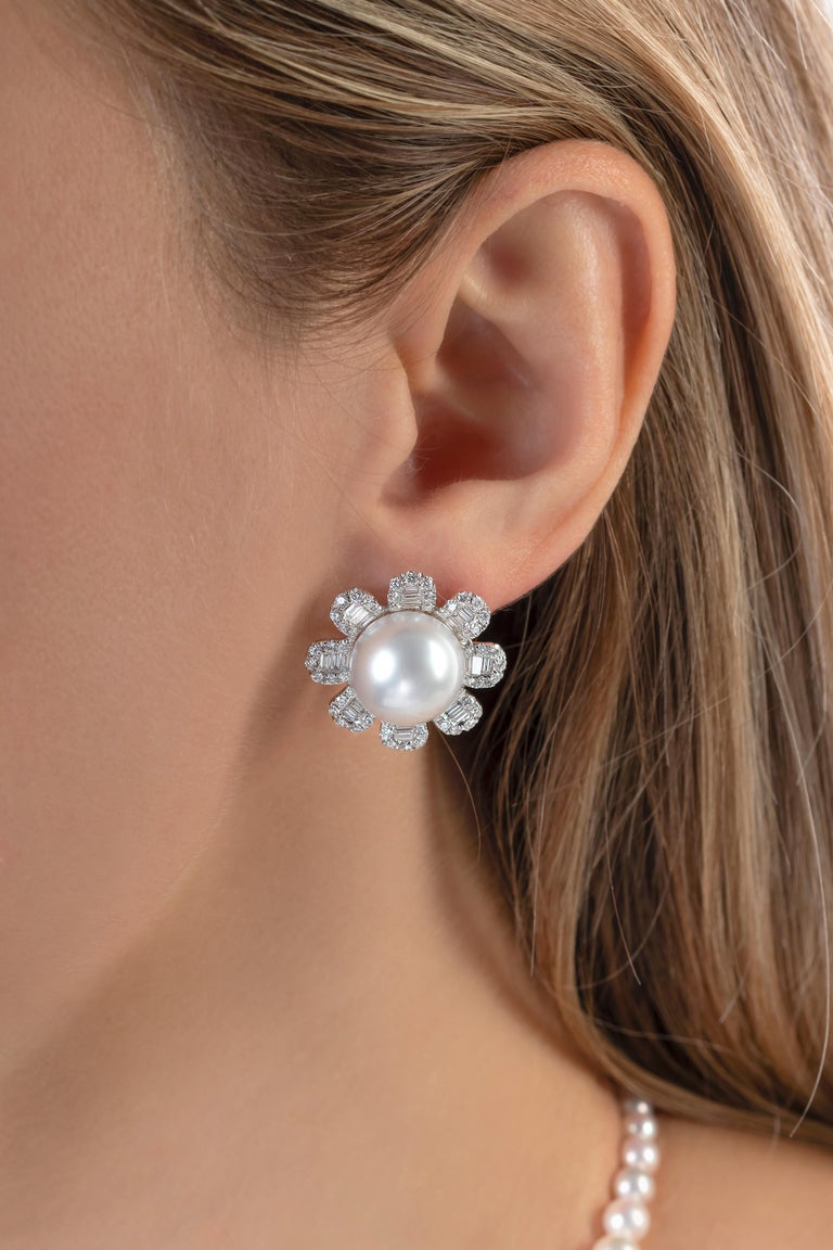 These unique earrings by Yoko London feature lustrous South Sea pearls set in the centre of scintillating diamond petals. The South Sea pearls have been selected for their high lustre and set in our London atelier. The perfect companion for any