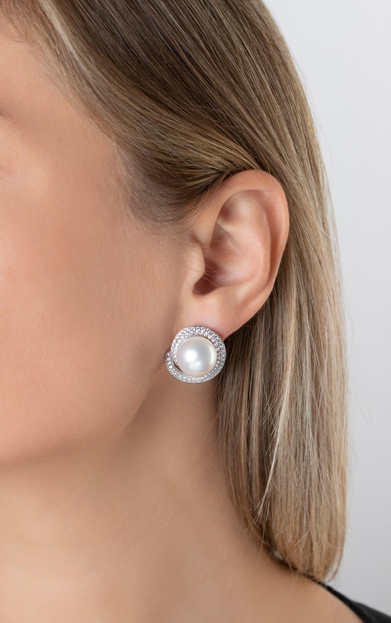 These statement earrings by Yoko London feature two lustrous South Sea Pearls set among a bold twist of diamonds. Sure to make an impression, these earrings will help you stand out from the crowd at glamorous events. Each pearl has been hand