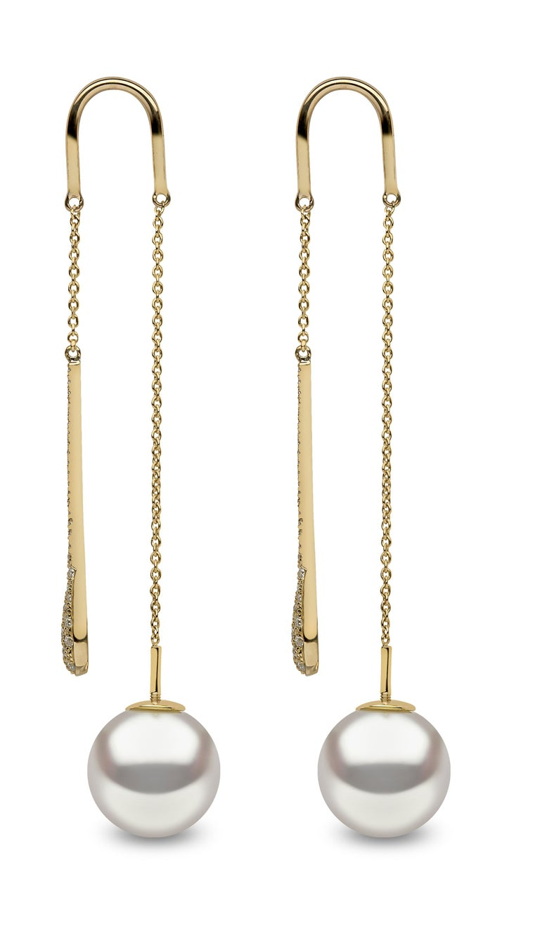 These contemporary earrings by Yoko London are extremely modern in their design. Featuring an elegant diamond drop which hangs from the front and a lustrous South Sea pearl which hangs from behind the lobe. To put these earrings on, you simply