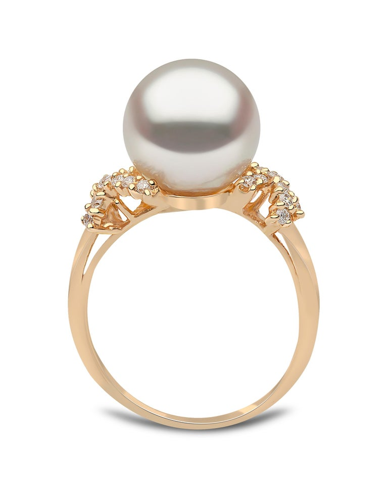 This graceful ring by Yoko London features a lustrous South Sea pearl set between two diamond 'kisses'. The 18 Karat yellow gold setting enriches the radiance of the South Sea pearl and the white sparkle of the diamonds. This ring holds romantic