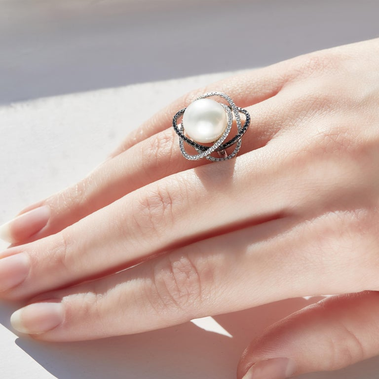 This exceptional ring by Yoko London features a lustrous South Sea pearl surrounded by delicate orbits of black and white diamonds. Expertly crafted in 18 Karat white gold in our London atelier, this striking ring adds a unique twist to the most