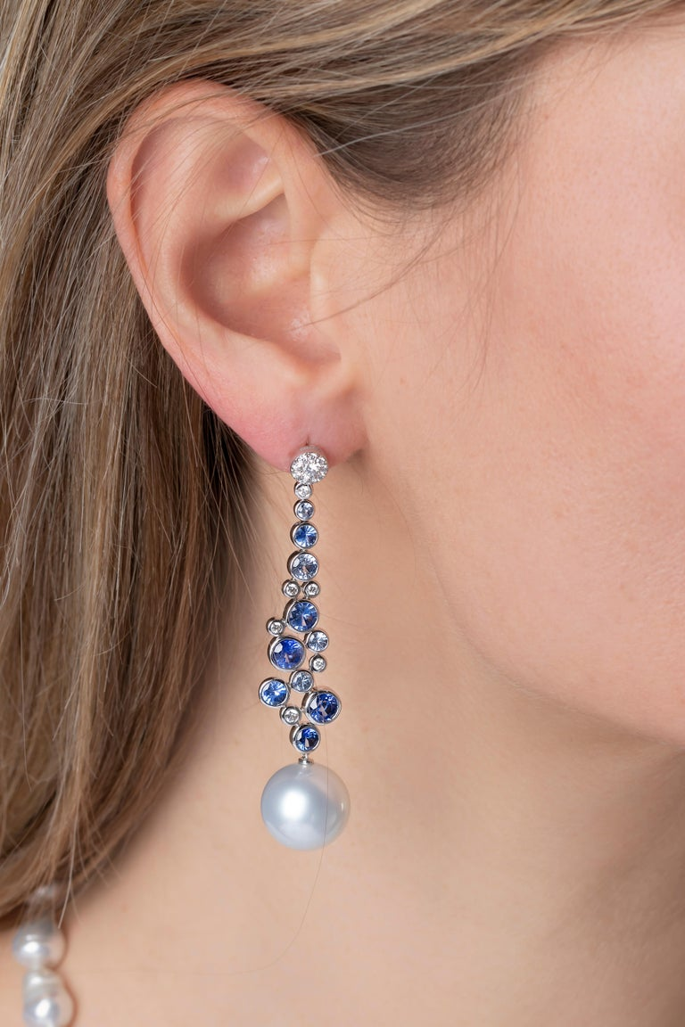 These striking earrings by Yoko London feature lustrous South Sea pearls beneath a scattering of sapphires and diamonds. These earrings have been masterfully engineered in our London atelier to move with their wearer, meaning they exude a constant