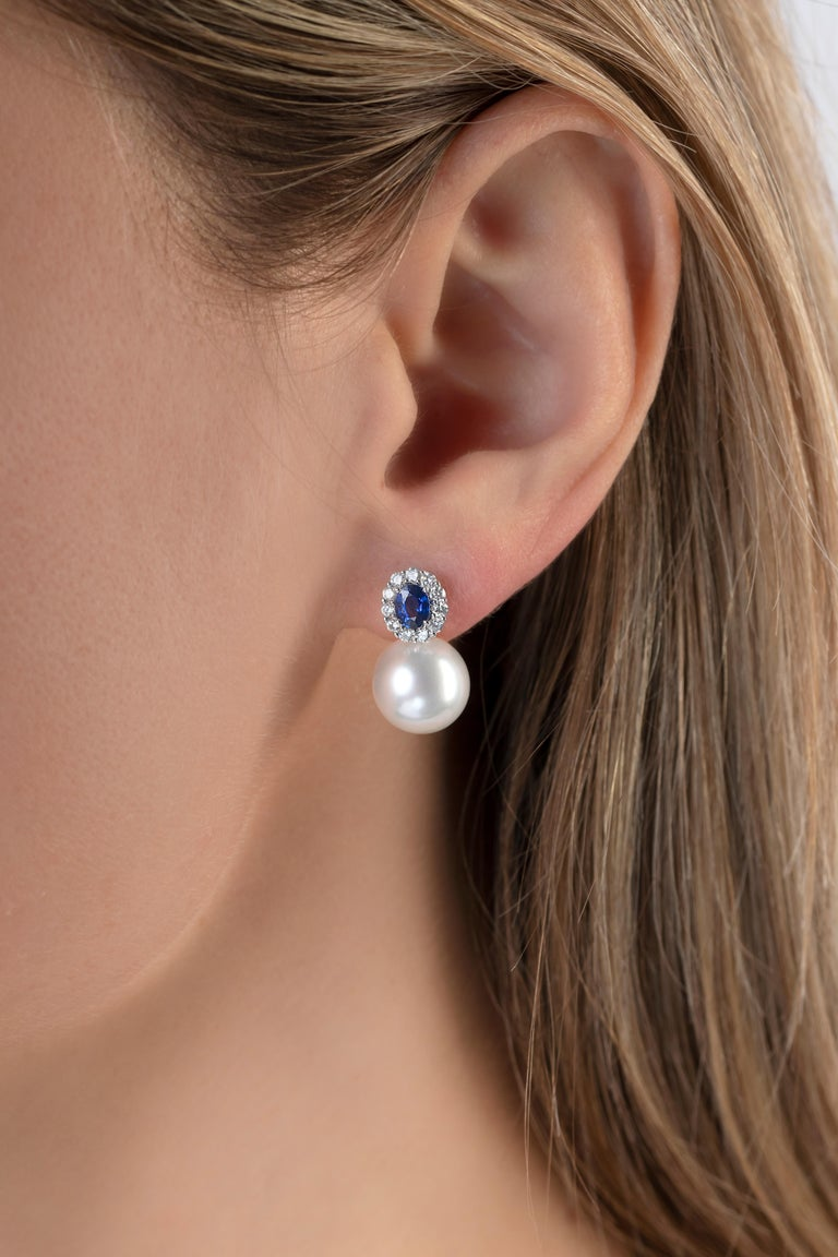 These important earrings by Yoko London feature a vivid blue sapphire set among a cluster of diamonds, atop two perfectly matched South Sea pearls. An iconic design re-imagined, these earrings are sure to bestow the wearer with a glamorous look,
