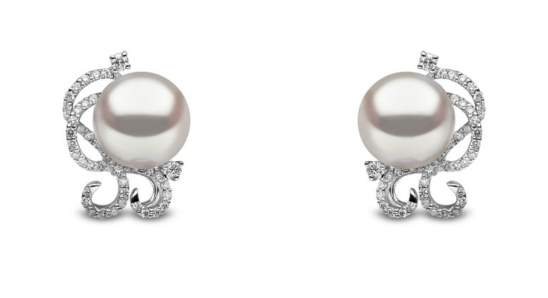 These elegant earrings by Yoko London feature two lustrous South Sea pearls, perfectly accented by an opulent arrangement of diamonds. These intricate earrings have been designed and hand finished to the highest by some of the world's leading pearl