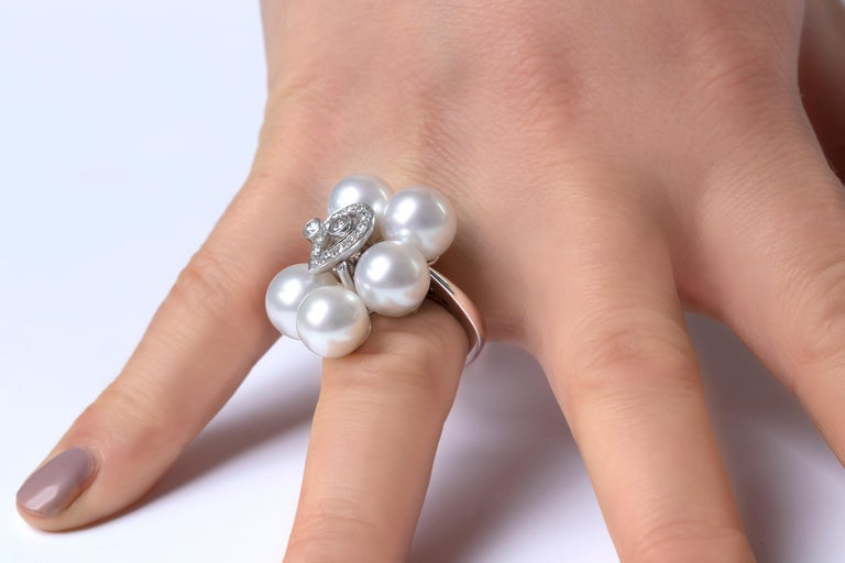 This contemporary ring by Yoko London features five lustrous South Sea pearl rings, surrounding an elegant arrangement of diamonds. Modern and stylish, this ring will make a statement whenever and however it is styled.   -9.5-10mm South Sea Pearls
