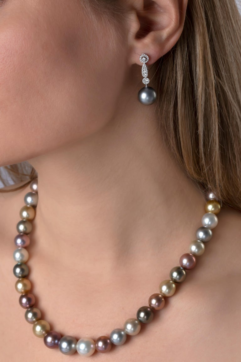These elegant earrings by Yoko London feature cool grey Tahitian pearls beneath a dazzling arrangement of diamonds. Striking and sophisticated, these earrings will add a touch of glamour to any evening outfit.   -12-13mm Tahitian Pearls  -100