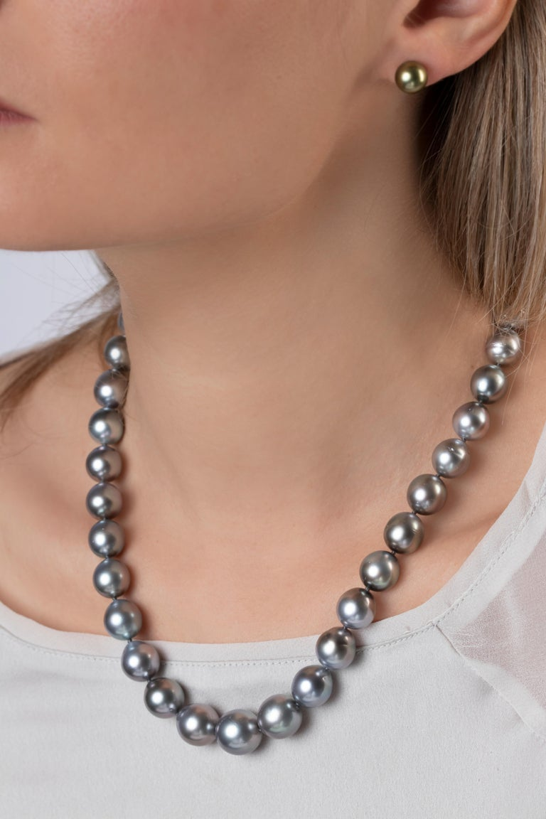 This elegant necklace by Yoko London features a row of alluring grey Tahitian pearls secured to a matt finished 18K white gold clasp. A classic style for a timeless look, this necklace is easily styled with both casual and formal attire.  Each pearl
