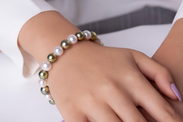 This unusual bracelet by Yoko London features white and Pistachio  This unusual bracelet from Yoko London features a row of 9mm alternating white Freshwater and Pistachio-Coloured Tahitian Pearls secured on elastic to allow for maximum comfort. To