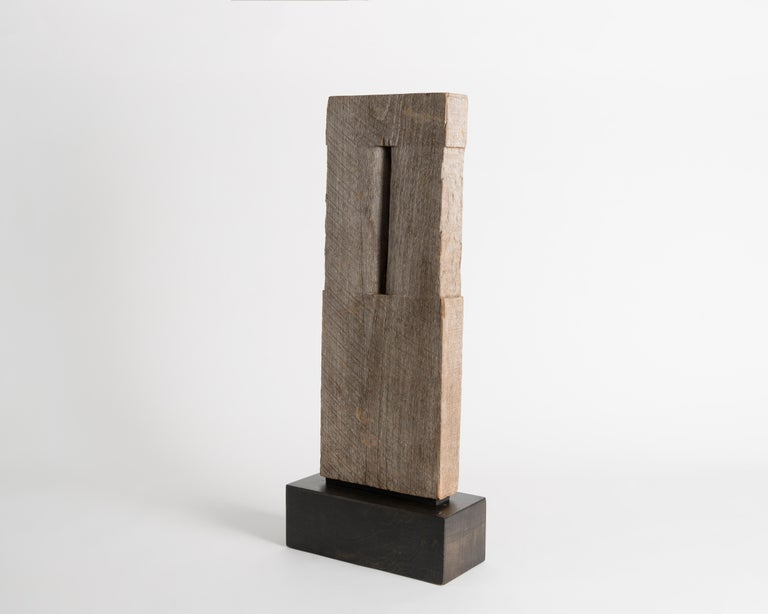 Sculpted in 1985, this is a rare piece for the famed sculptor Yongjin Han, who usually worked in stone. Nonetheless, it is a quintessential example of his serene compositions.