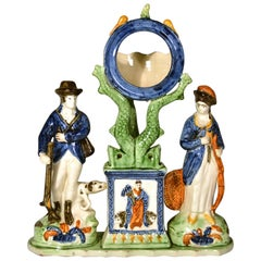 Yorkshire Pearlware Watch Holder Flanked by Hunter and Huntress, Prattware