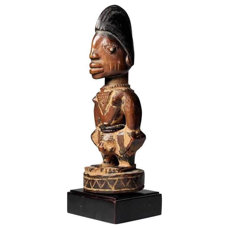 """Yoruba People, Nigeria, Carved Twin Figure """"Ibeji"""" For Sale"""