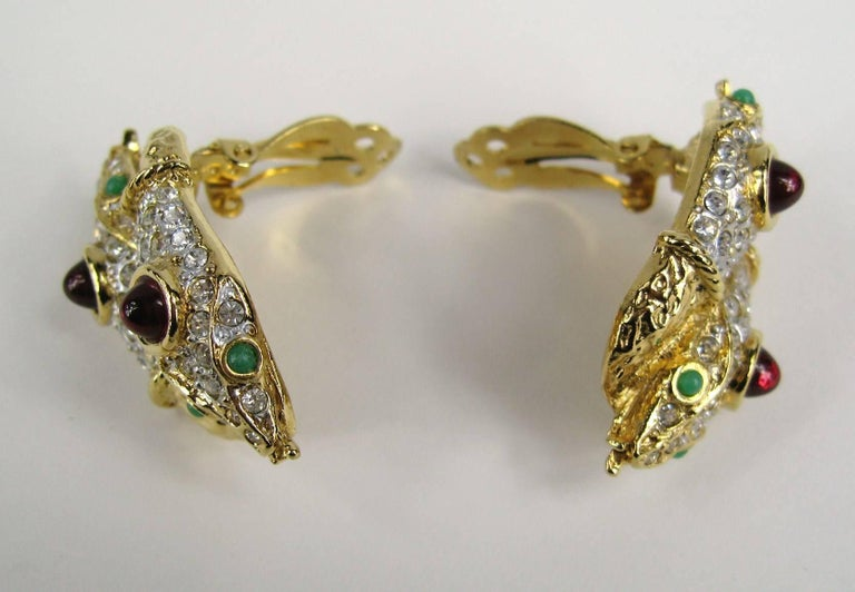 Yosca Star Double headed Snake Earrings, Clip on's. Poured Glass with crystals  Hallmarked- 1.60 in top to bottom x .85 in This is out of a massive collection of Contemporary designer clothing as well as Hopi, Zuni, Navajo, Southwestern, sterling